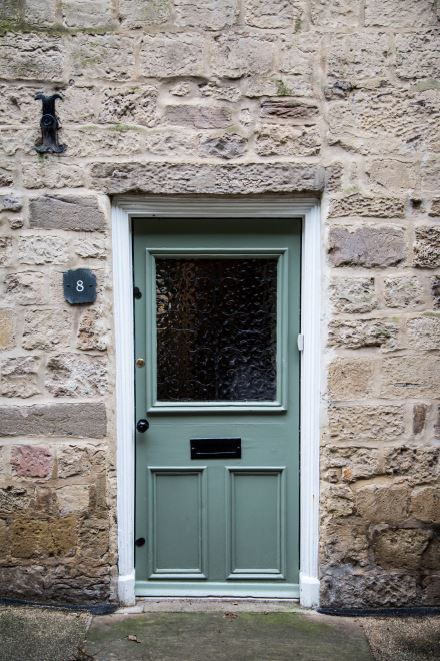 Beautiful green door with privacy glass, stone facade, No. 8, front doors with glass insert, sage, charming, old world, letter slot, door mail box, greenish grey, greenish gray, amid home