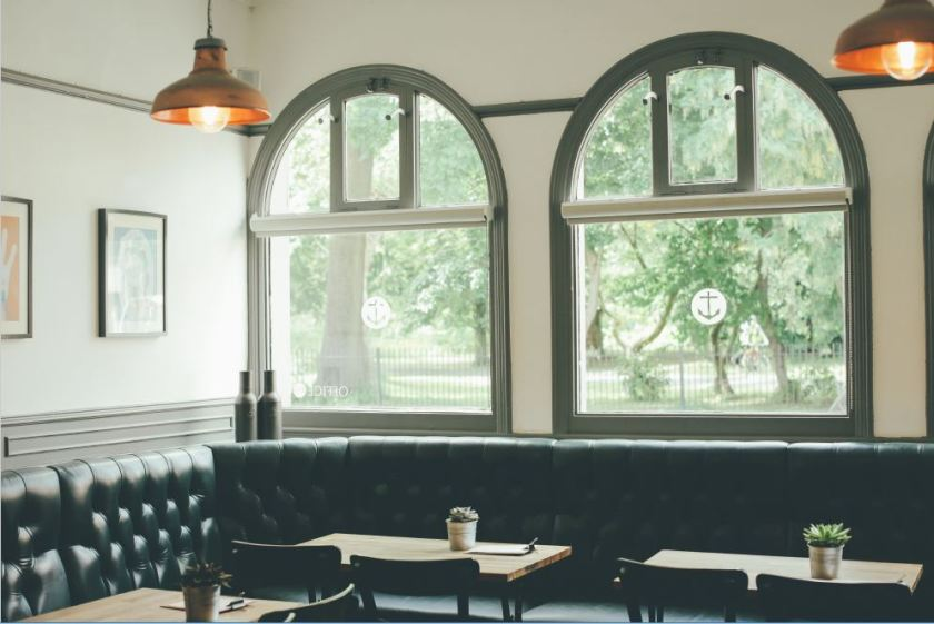 A booth AND a gorgeous sunny window!?! Let me curl up in there!, the anchor, comfortable seating, restaurant design, amid home, arched windows, butcher block tables, dark painted trim, cozy, comfy, dining in style, cafe life